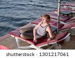 middle aged woman in a striped... | Shutterstock . vector #1301217061