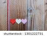 Three Hearts On A Wooden...