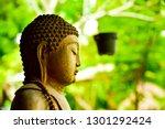 calm sitting buddha stone rock... | Shutterstock . vector #1301292424