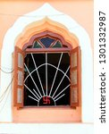 Small photo of Open window of jain temple with swastika on it, an ancient symbol of divinity and spirituality in India