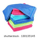 stacked colorful towels on a... | Shutterstock . vector #130135145