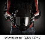 Motorcyclist With Helmet In His ...
