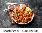 tandoori gobi   roasted... | Shutterstock . vector #1301429731