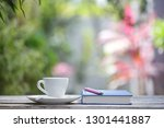white coffee cup with plant and ... | Shutterstock . vector #1301441887