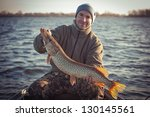 Happy Angler With Pike Fishing...