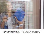beautiful young woman cleaning... | Shutterstock . vector #1301460097