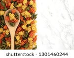 trotolle tricolour pasta on a... | Shutterstock . vector #1301460244