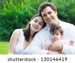 happy young family with baby... | Shutterstock . vector #130146419