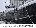 obsolete trawler at a ship... | Shutterstock . vector #1301487901