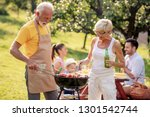 barbecue time. the older couple ...   Shutterstock . vector #1301542744