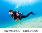 Female Scuba Diver Over Sand I...