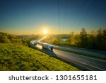 three white trucks driving on... | Shutterstock . vector #1301655181