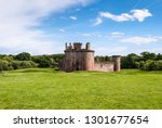 Triangular shaped castle with water filled moat originally built in 13th century, Caerlaverock Castle, Scotland.