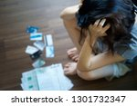 stressed young asian woman... | Shutterstock . vector #1301732347