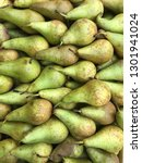 green fresh pears background... | Shutterstock . vector #1301941024