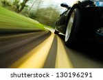 front side view of black car in ... | Shutterstock . vector #130196291