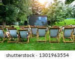 people in a summer cinema are... | Shutterstock . vector #1301963554