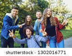 friends walk laughing in the... | Shutterstock . vector #1302016771
