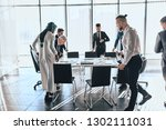 companions sitting down on... | Shutterstock . vector #1302111031