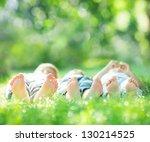Happy Family Lying On Green...