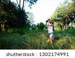 girl using binoculars in the... | Shutterstock . vector #1302174991