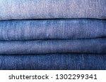 stack of jeans texture ...   Shutterstock . vector #1302299341