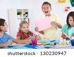 glad little boy showing his... | Shutterstock . vector #130230947