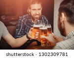 glass of crafting beer in bar.... | Shutterstock . vector #1302309781