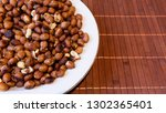 roasted peanuts snack in white... | Shutterstock . vector #1302365401