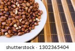 roasted peanuts snack in white... | Shutterstock . vector #1302365404