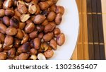 roasted peanuts snack in white... | Shutterstock . vector #1302365407