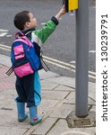 Child Pressing A Button At...