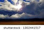 dramatic late autumn cloudscape | Shutterstock . vector #1302441517