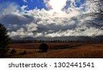 dramatic late autumn cloudscape | Shutterstock . vector #1302441541