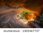 light through a sandstone cave... | Shutterstock . vector #1302467737