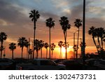 sunset at huntington beach  ... | Shutterstock . vector #1302473731