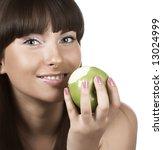 young girl eating green apple | Shutterstock . vector #13024999