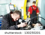 worker in uniform checking... | Shutterstock . vector #130250201