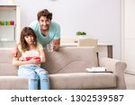 young family helping each other ...   Shutterstock . vector #1302539587