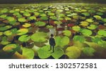 young man on giant lily pad... | Shutterstock . vector #1302572581