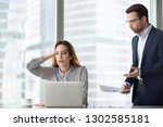 angry boss scolding terrified... | Shutterstock . vector #1302585181