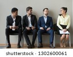 Small photo of Diverse male applicants looking at female rival among men waiting for at job interview, professional career inequality, employment sexism prejudice, unfair gender discrimination at work concept