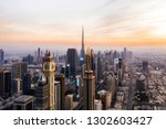 aerial view of dubai at sunset... | Shutterstock . vector #1302603427