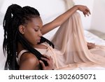 beautiful african woman with... | Shutterstock . vector #1302605071
