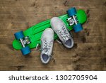 child sneakers and overturned... | Shutterstock . vector #1302705904