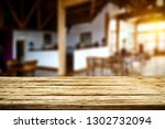 desk of free space and blurrred ... | Shutterstock . vector #1302732094
