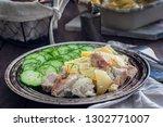 roast pork with potatoes ... | Shutterstock . vector #1302771007