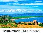 the beach tombolo di feniglia... | Shutterstock . vector #1302774364