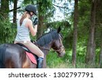 bay horse with young teenage... | Shutterstock . vector #1302797791