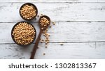 soybeans in wooden cups and... | Shutterstock . vector #1302813367